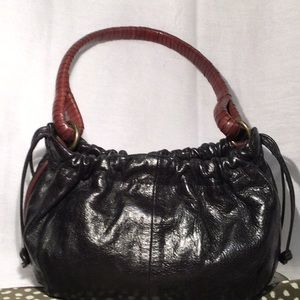 Fossil Drawstring Handbag with contrast le…